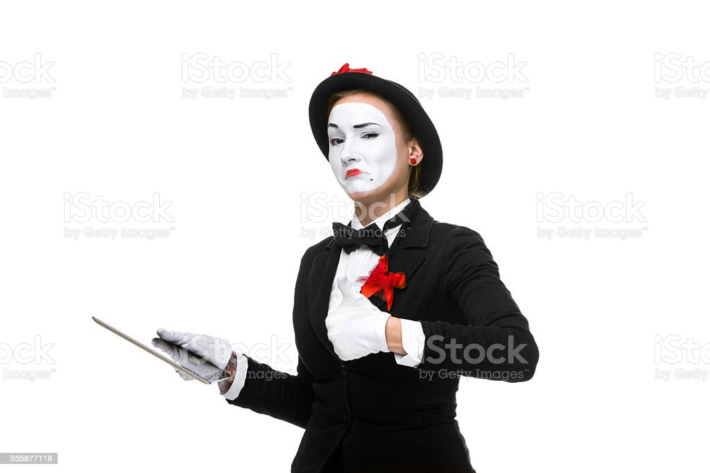 business woman in the image mime holding tablet PC stock photo