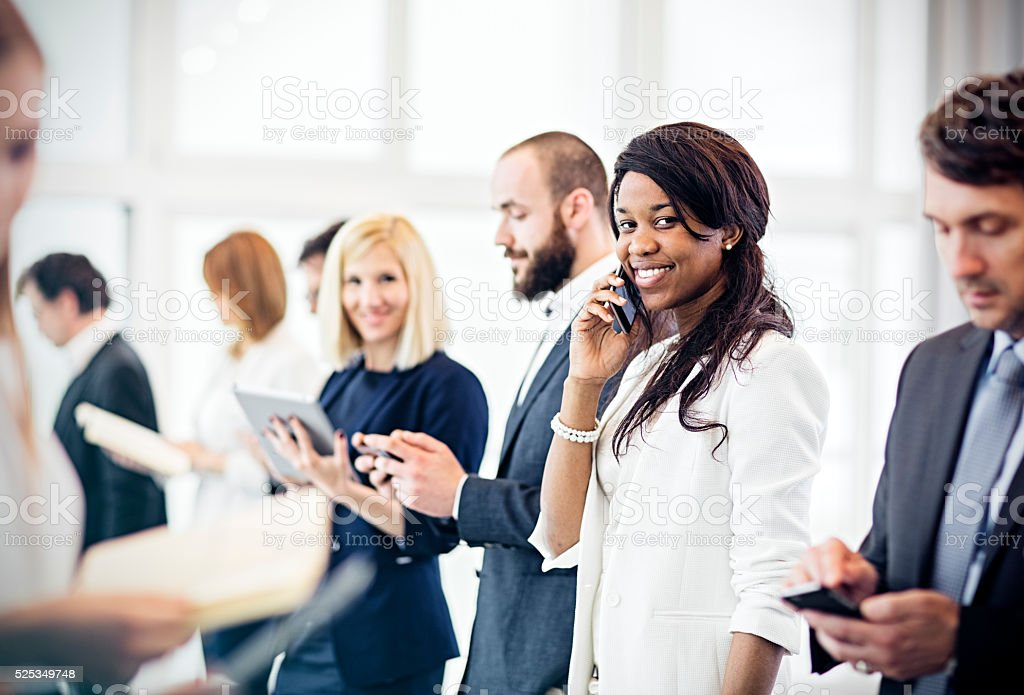 business woman   in  the office using mobile phone stock photo