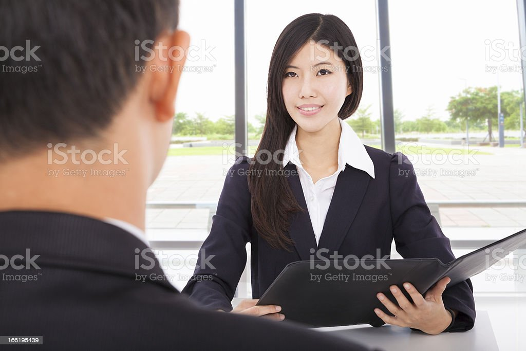 business woman interviewing with businessman in office royalty-free stock photo