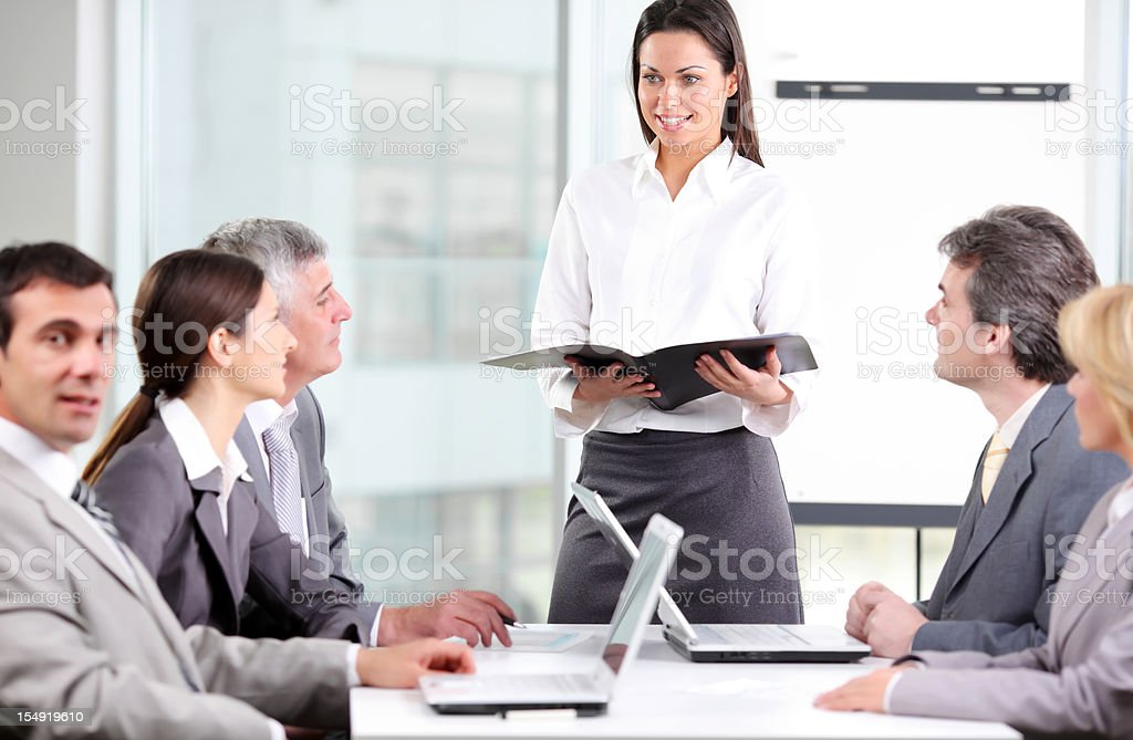 Business woman is explaining to her colleagues on the meeting. royalty-free stock photo