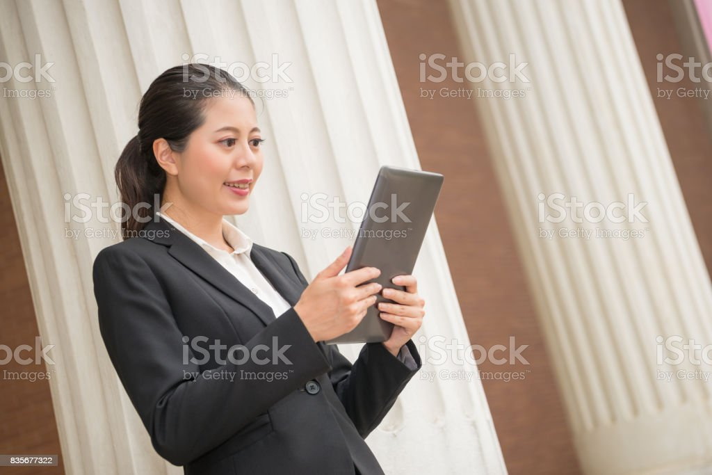 business woman lawyer watching mobile computer stock photo