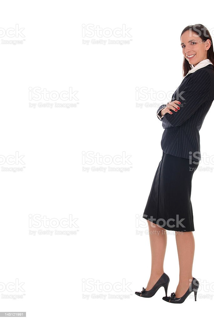 Business woman leaning against wall royalty-free stock photo