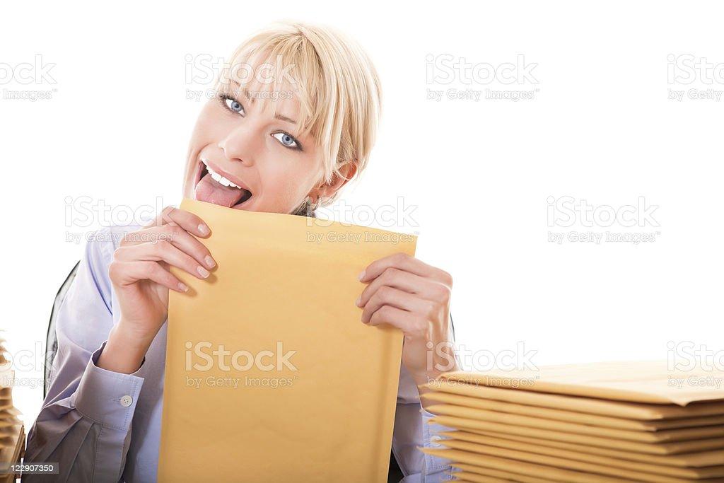 Business woman licking envelops royalty-free stock photo