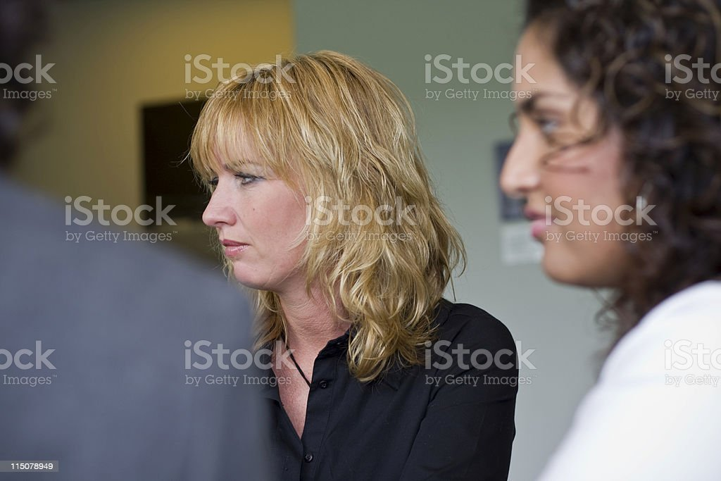 Business woman listening closely royalty-free stock photo