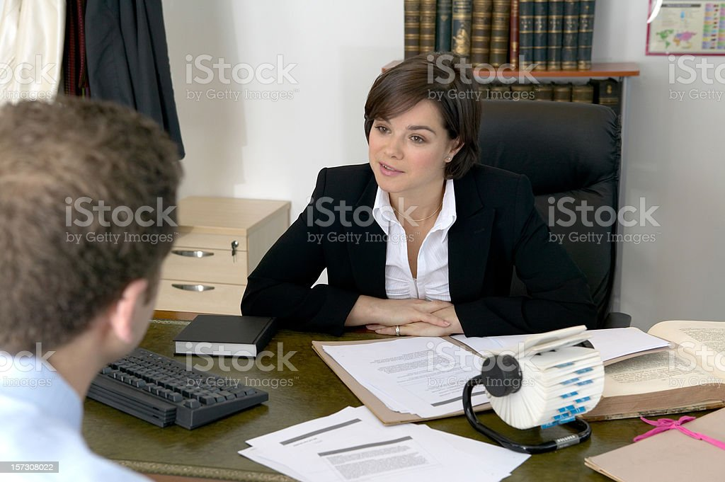 Business Woman listening in a meeting royalty-free stock photo