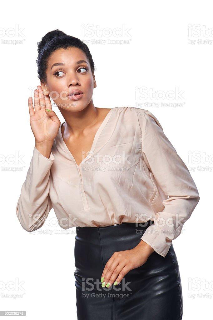 Business woman listening to gossip stock photo