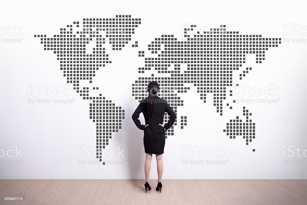 business woman look world map stock photo