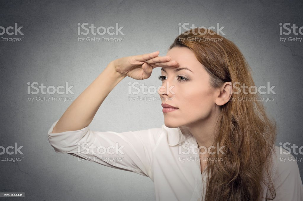 Business woman looking away into the future monitoring stock photo