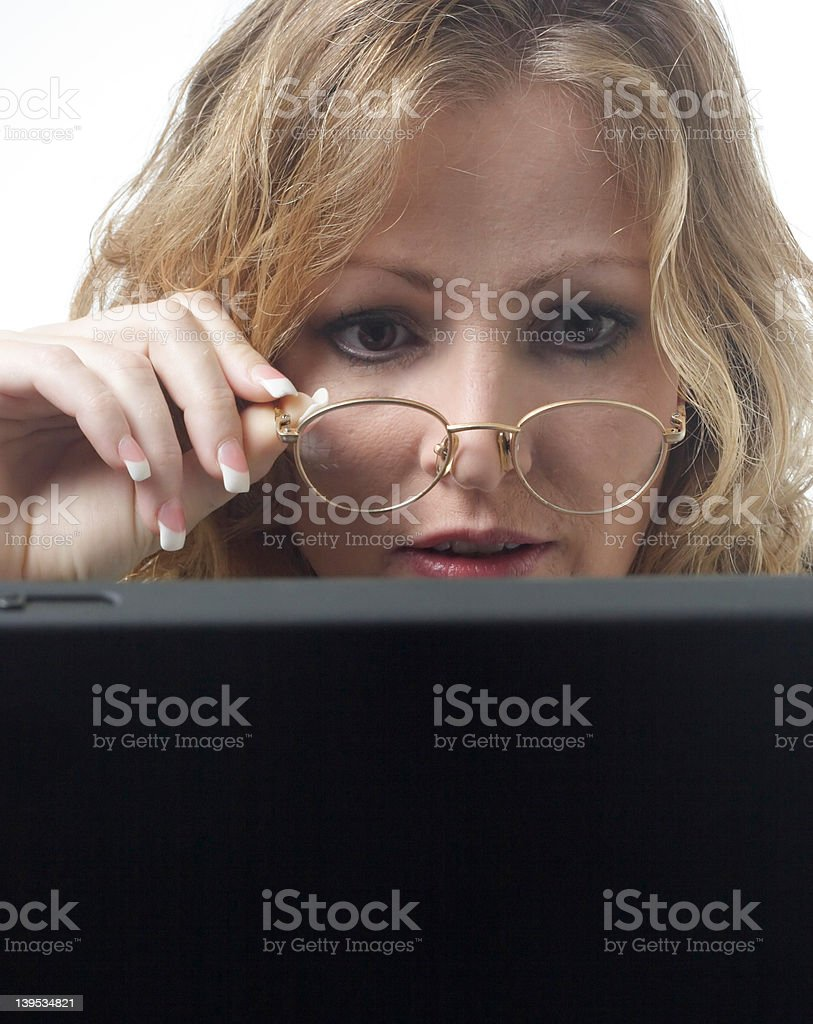 Business woman looking closely at laptop stock photo