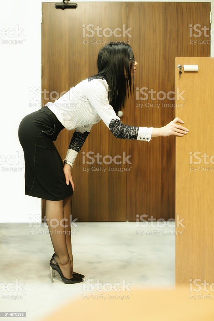 Business woman looking in a cupboard for a document stock photo