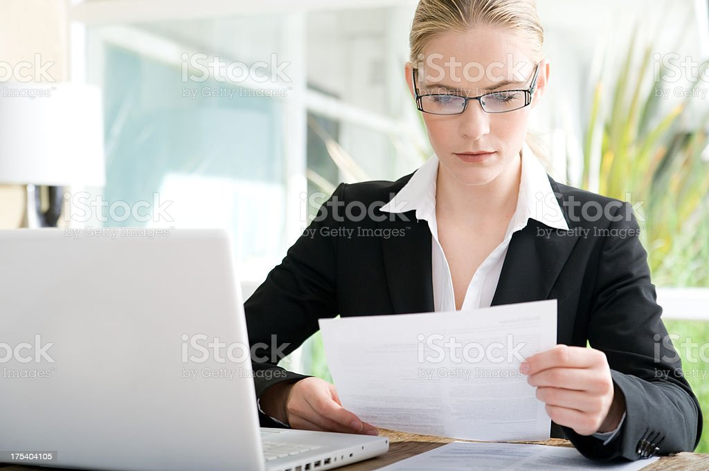 Business woman looking over papers royalty-free stock photo