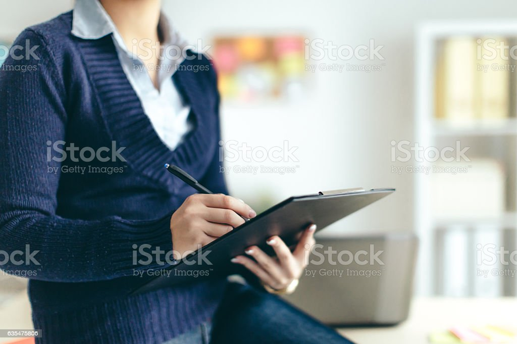 Business woman looking over papers stock photo