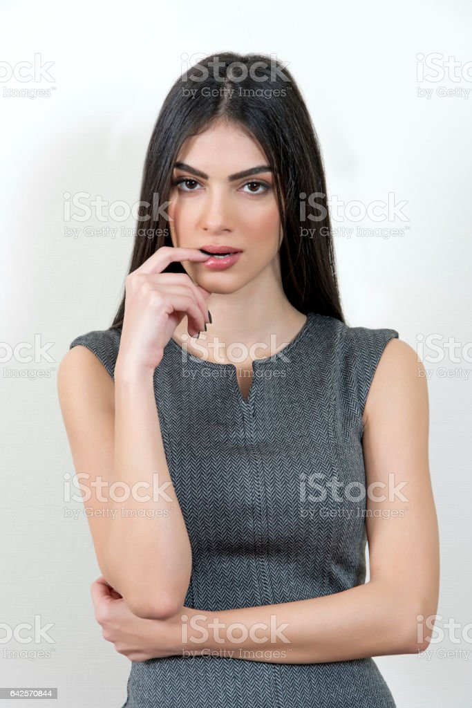 Business woman looking shy at the camera. stock photo