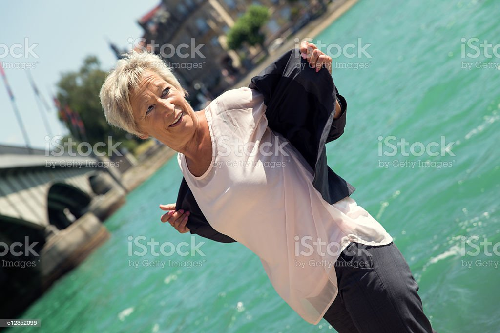 Business woman making a break on the Water stock photo