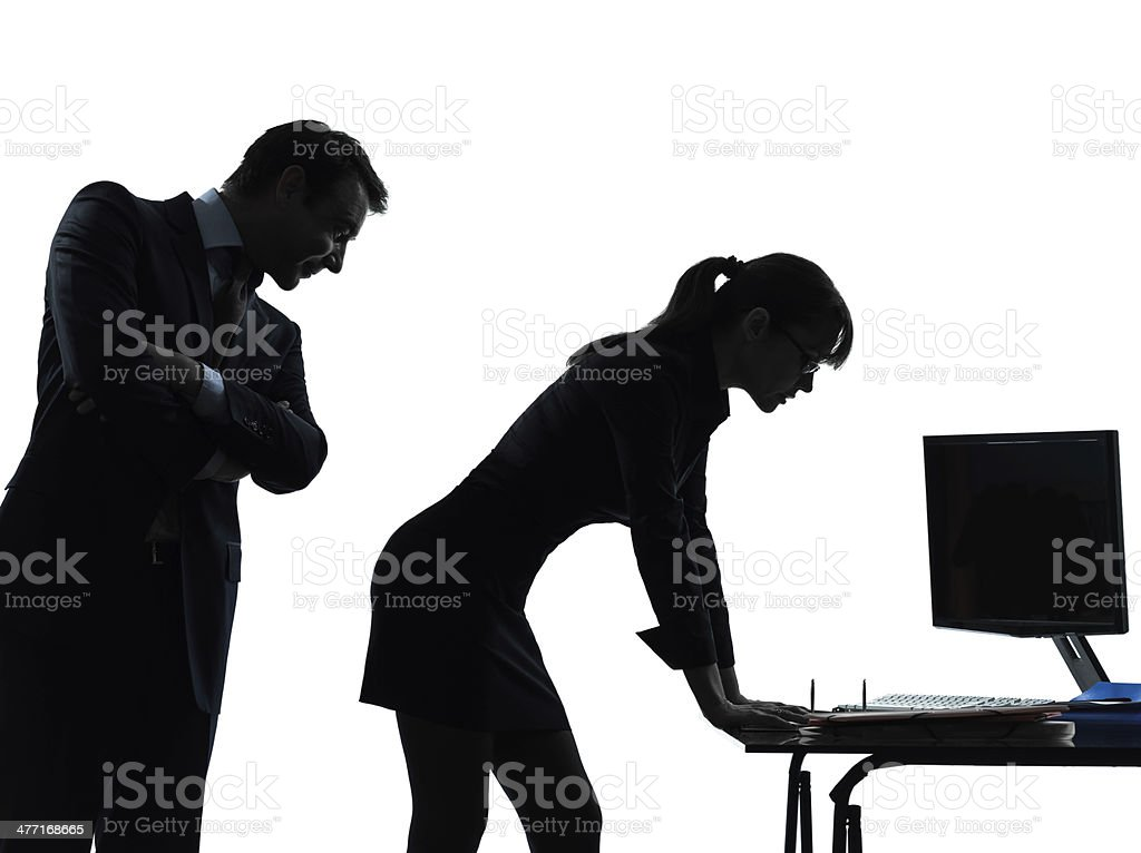business woman man couple sexual harassment silhouette stock photo