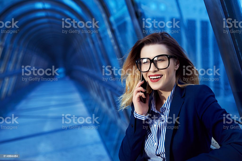 business woman on the phone smiling stock photo
