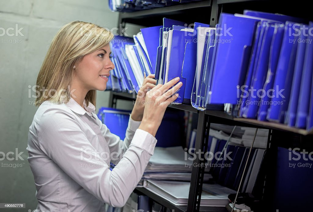 Business woman organizing files at the office stock photo