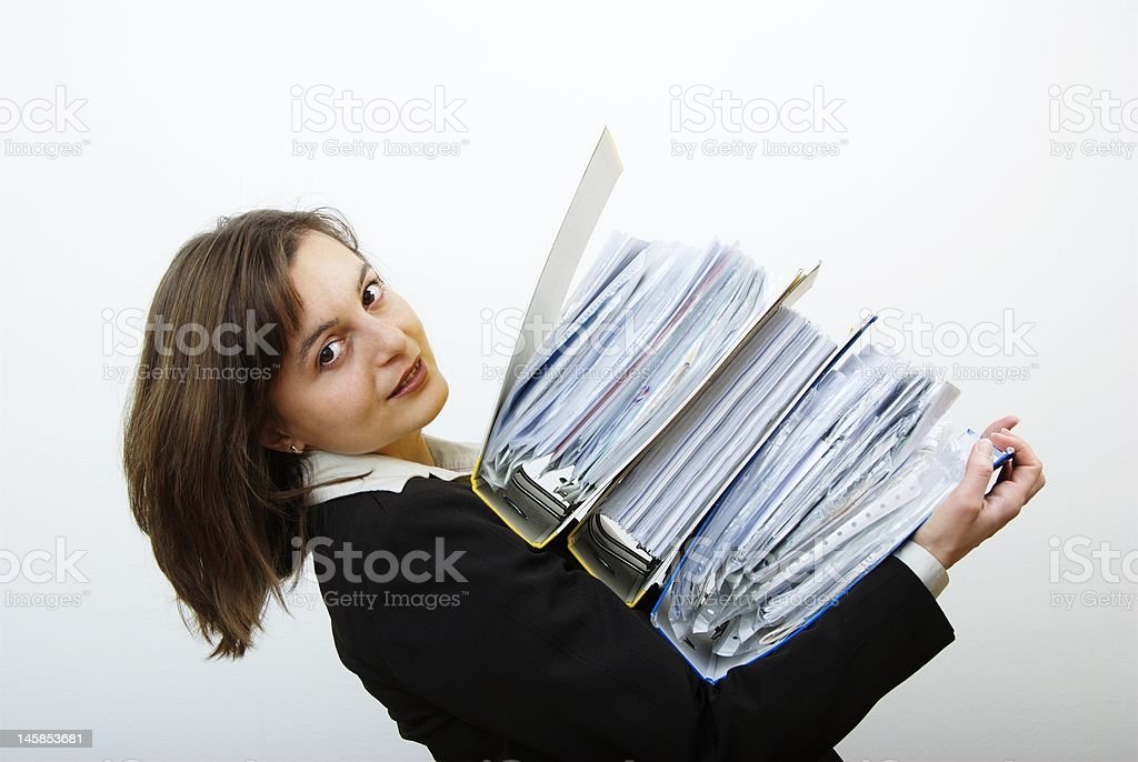 Business woman overloaded with heavy files royalty-free stock photo
