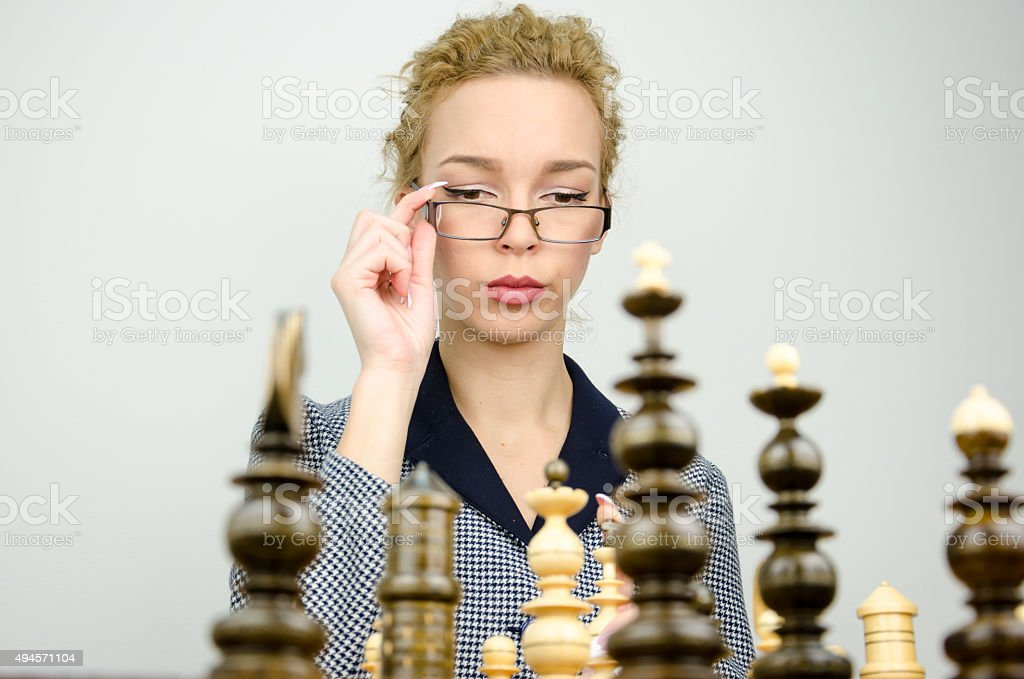 Business woman play chess stock photo