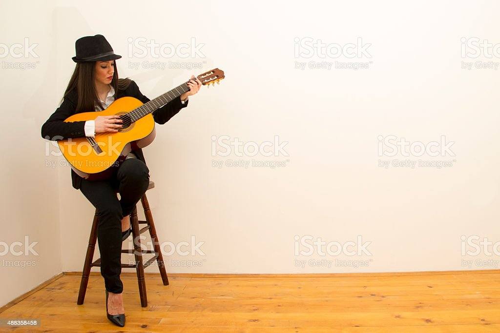 Business Woman Playing Blow Up Guitar stock photo