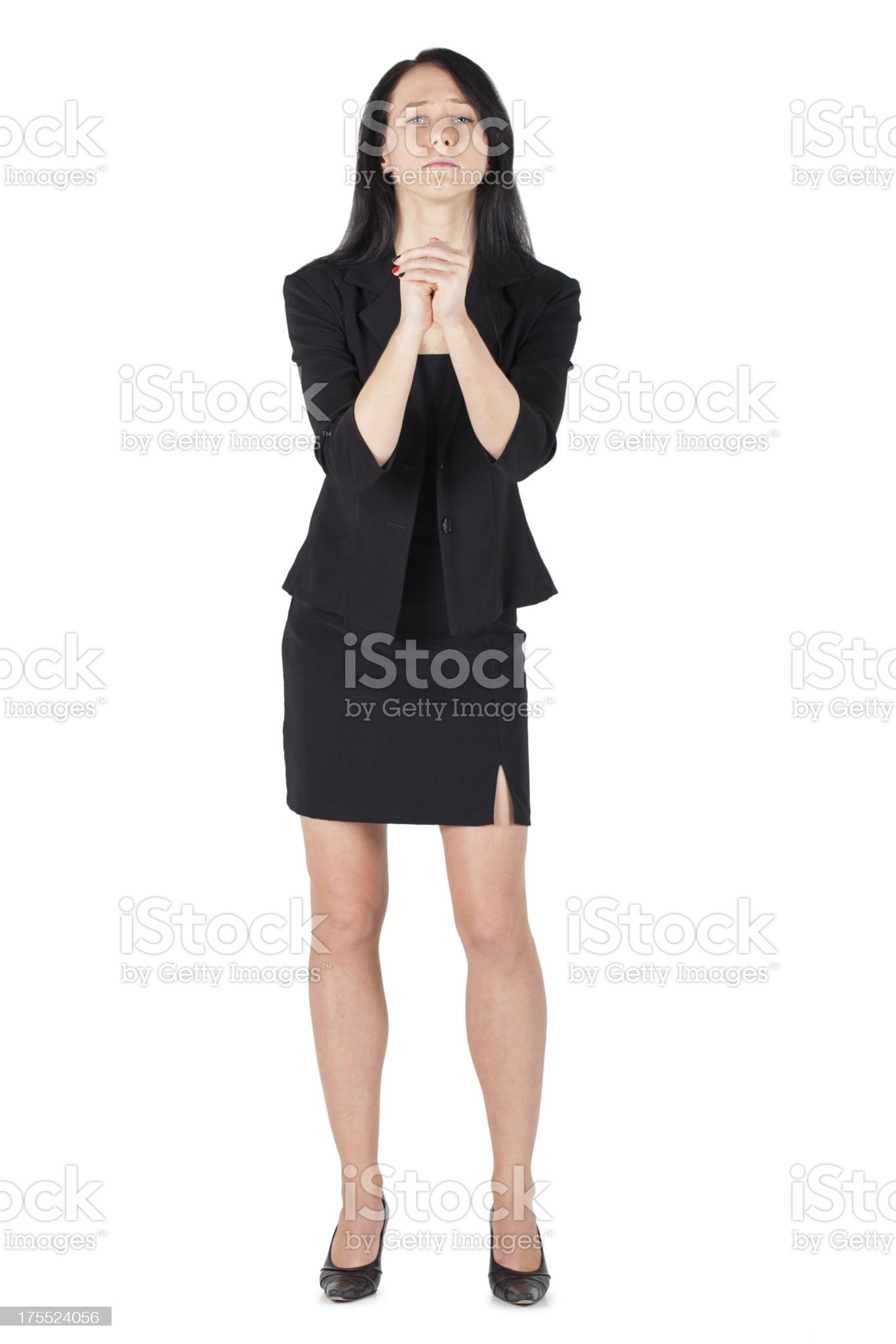 Business woman pleading hands clasped isolated royalty-free stock photo
