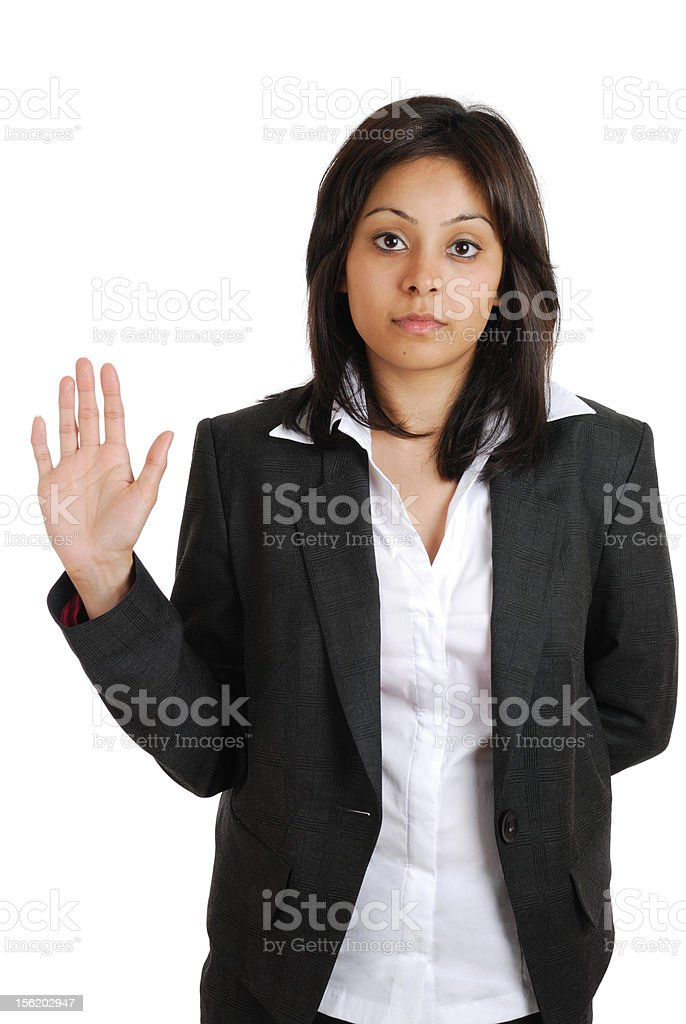 Business woman pledging with hand raised stock photo