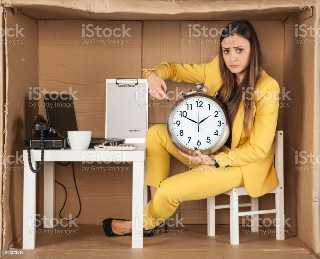 business woman pointing at ending time stock photo