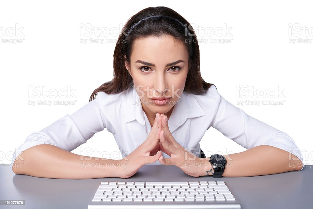 Business woman pointing at imaginary button stock photo