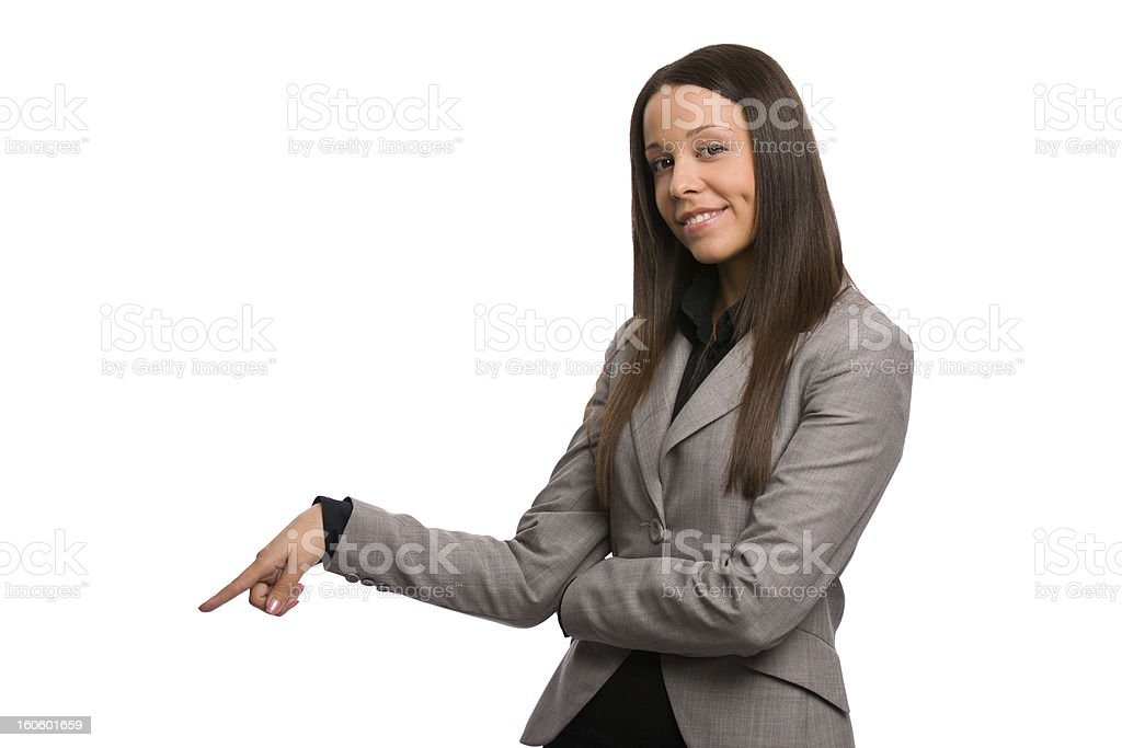 Business woman pointing down, looking at viewer and smiling stock photo