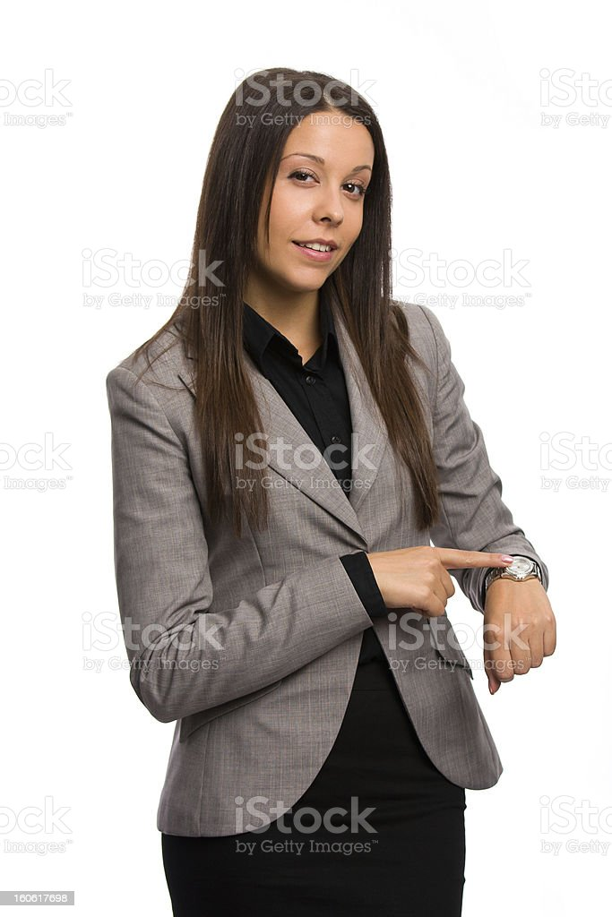 Business woman pointing her watch after a long waiting stock photo