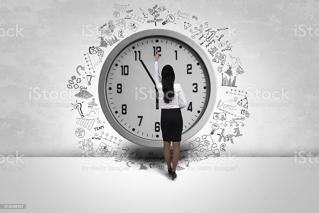 business woman pointing time stock photo