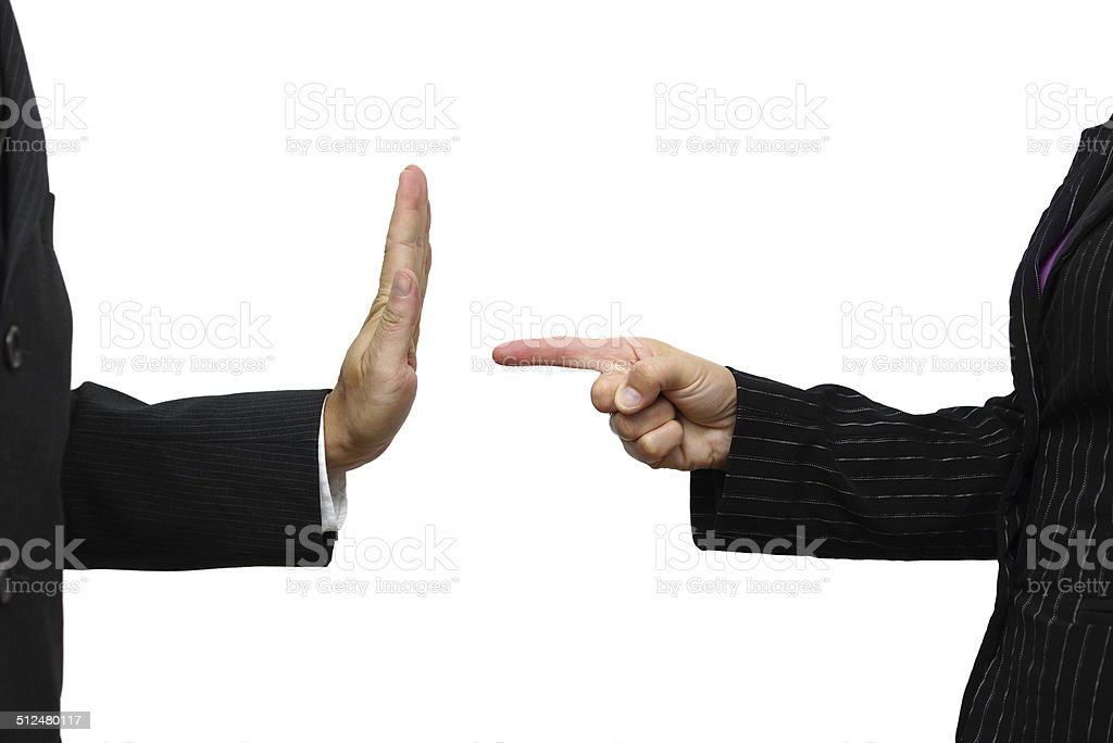business woman pointing to coworker. He refuses task stock photo
