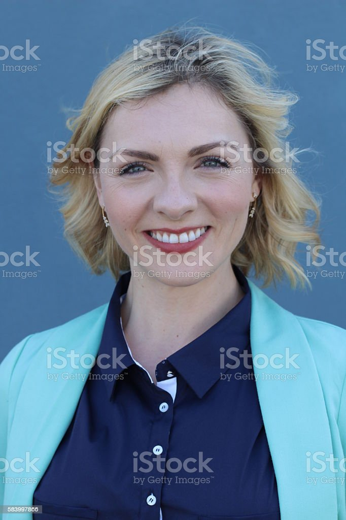 Business woman portrait isolated on blue stock photo