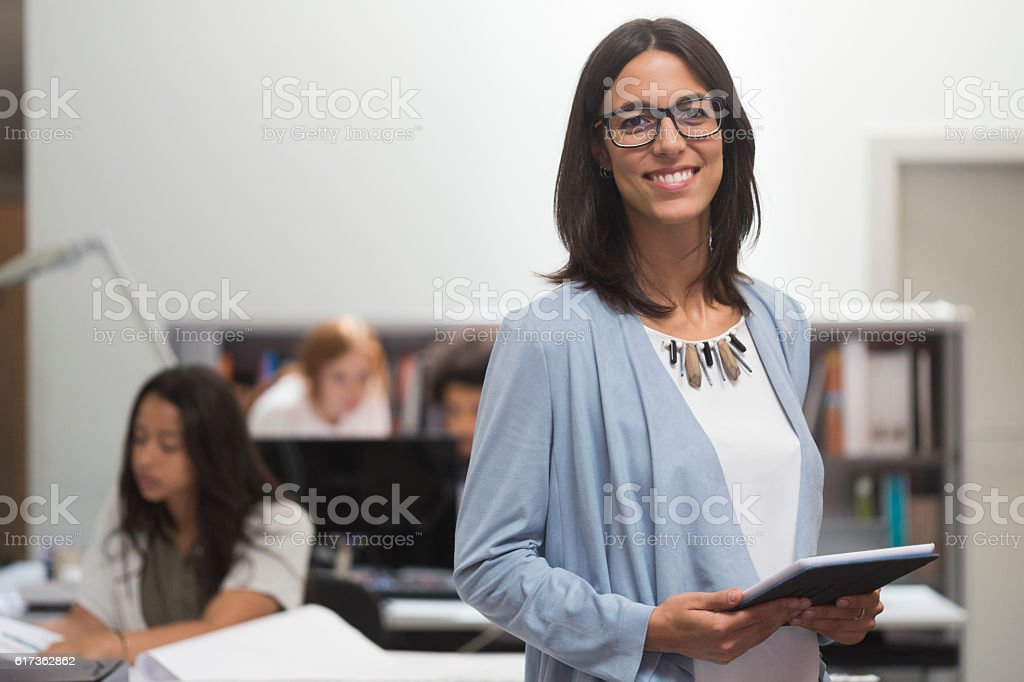 Business woman portrait looking at camera with incidental people stock photo