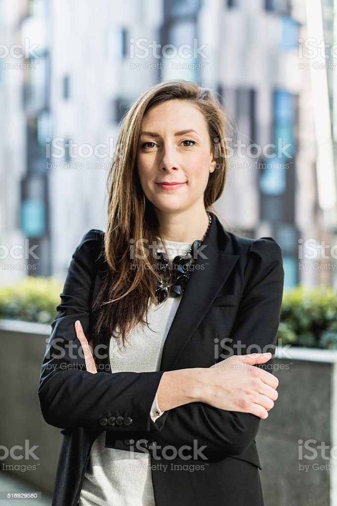 Business woman portrait with arm crossed stock photo