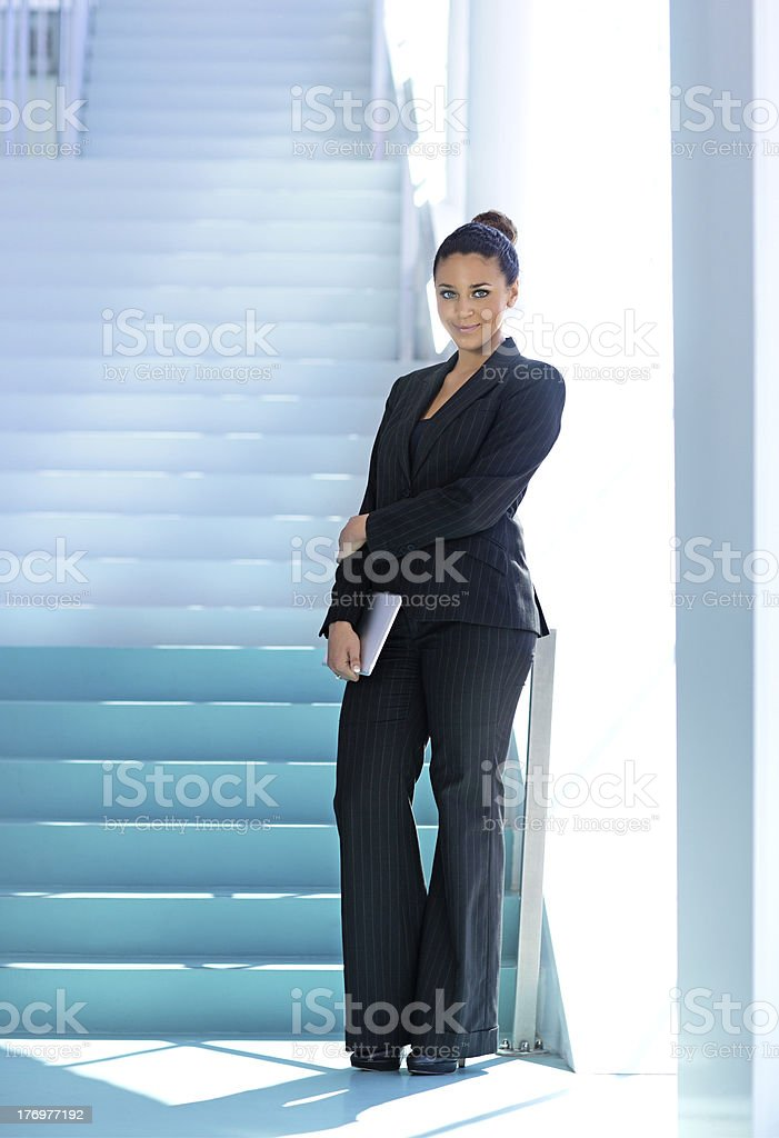 business woman posing against stairs royalty-free stock photo