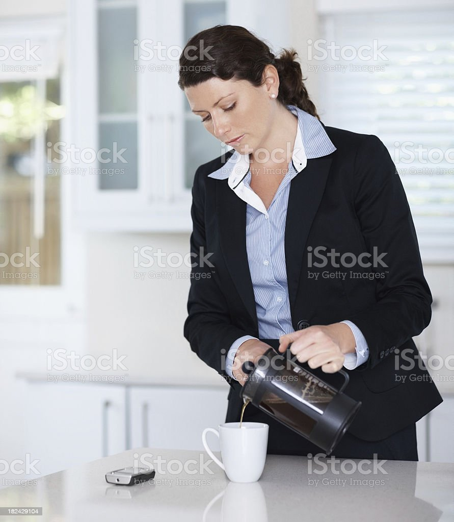 Business woman pouring herself a cup of coffee royalty-free stock photo