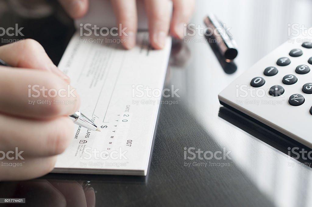 Business woman prepare writing a check stock photo