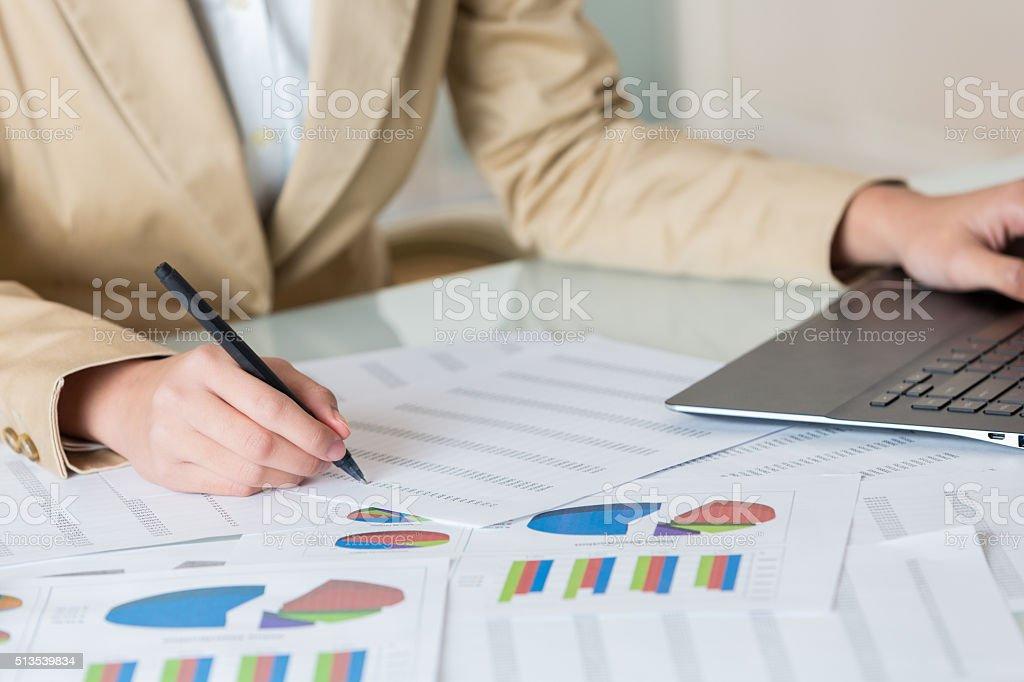 Business woman prepares financial data stock photo