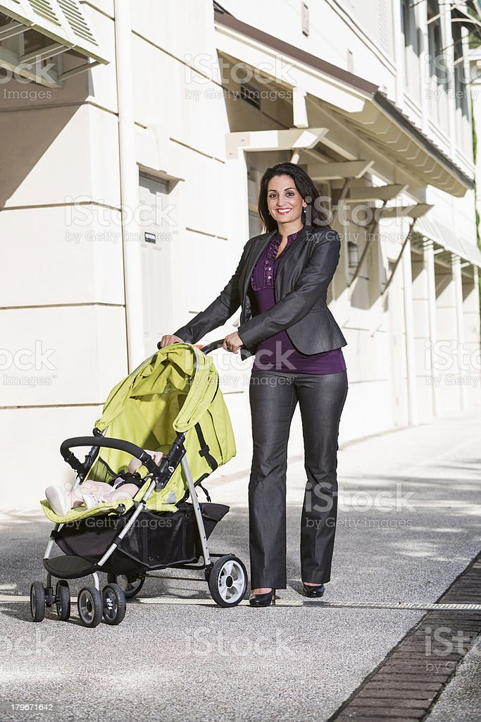 Business woman pushing baby stroller royalty-free stock photo