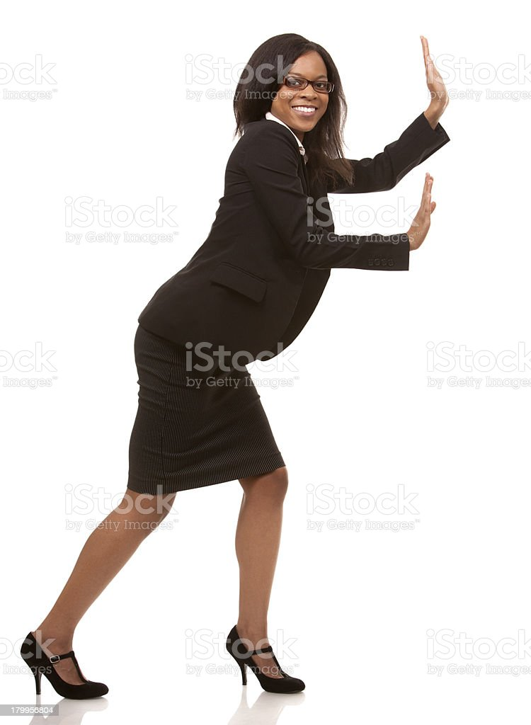 business woman pushing invisible object stock photo