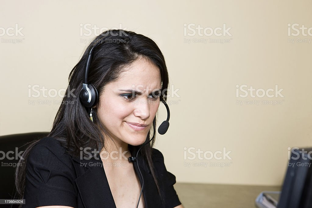 Business Woman Puzzled by Something On Her Computer royalty-free stock photo