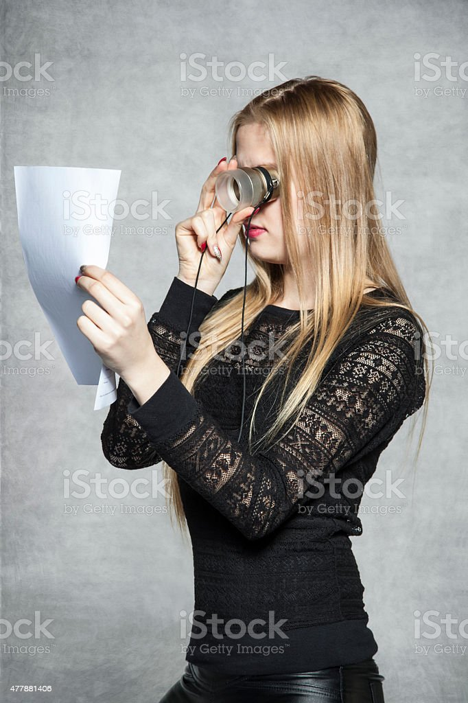 business woman reading a contract with the magnifying glass stock photo