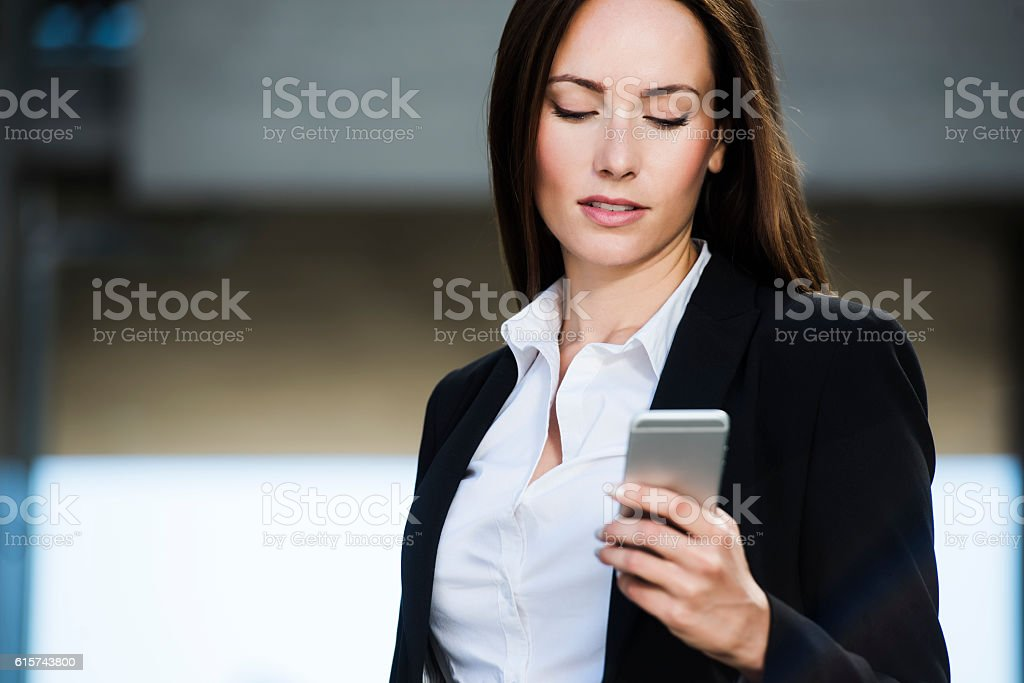 Business woman reading a text message stock photo