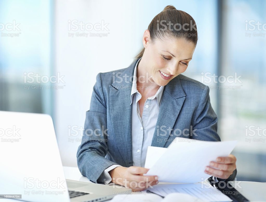 Business woman reading documents royalty-free stock photo