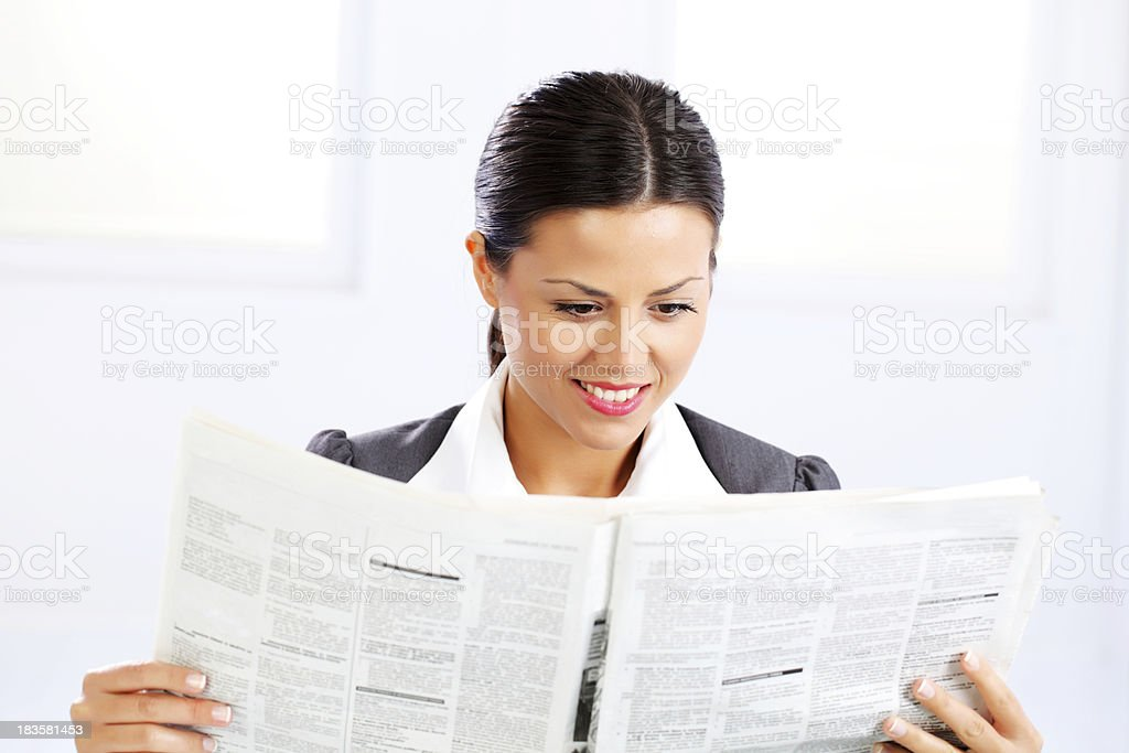 Business woman reads a newspaper. royalty-free stock photo