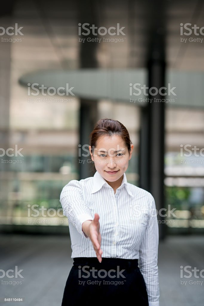 Business woman ready for a handshake stock photo