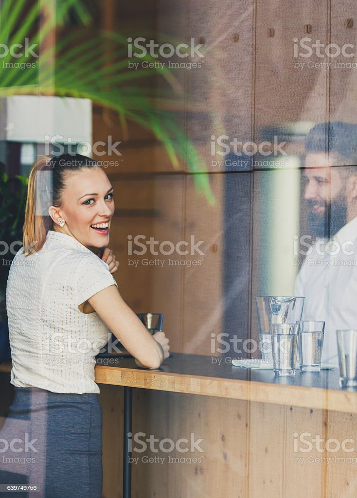 Business woman relaxing in the cafeteria stock photo