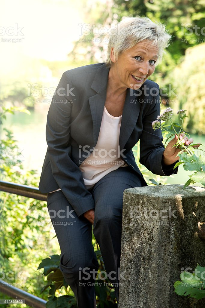business woman relaxing in the nature stock photo