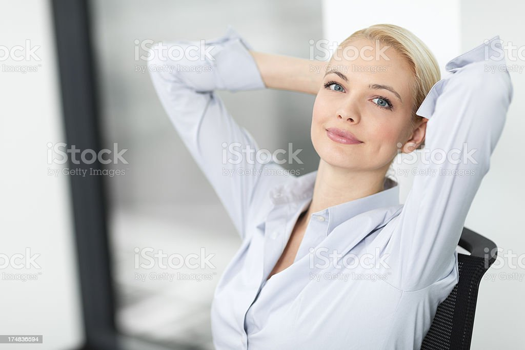 Business woman relaxing in the office stock photo